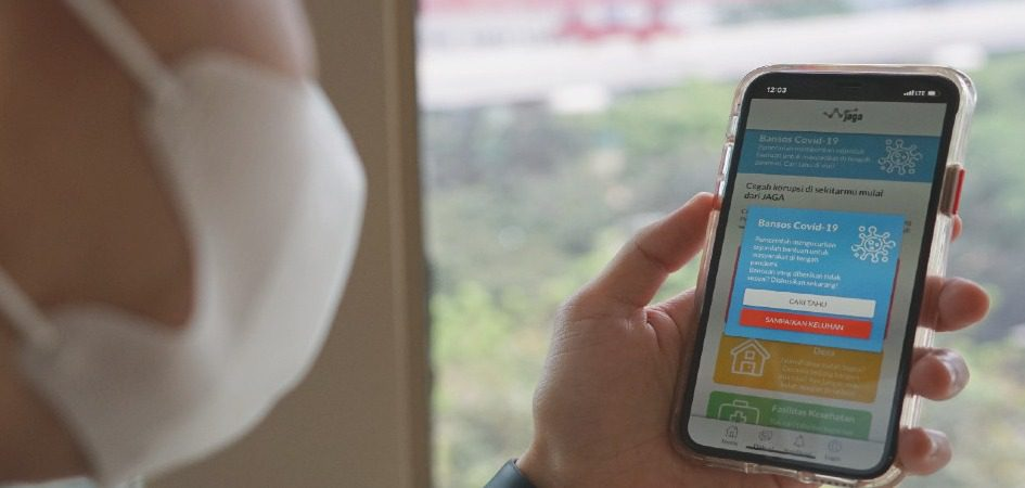 ILUSTRASI- Laporkan praktim pungli bansos melalui Fitur JAGA Bansos, yang ada dalam aplikasi JAGA. Aplikasi JAGA bisa diunduh melalui gawai dengan sistem operasi android ataupun iOs. FOTO: Dok. KPK/Lingkar.co