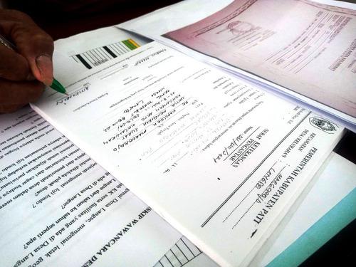 ILUSTRASI: Surat pengantar dari Pemdes Langse, Kecamatan Margorejo. (IBNU MUNTAHA/LINGKAR.CO)